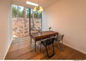 Office with wooded tree views and large windows at Martis Camp in Truckee.